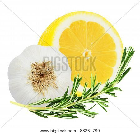 Juicy yellow lemon with a sprig of rosemary and garlic head