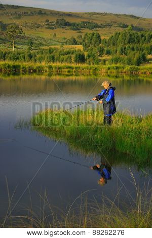 Lady fly fishing
