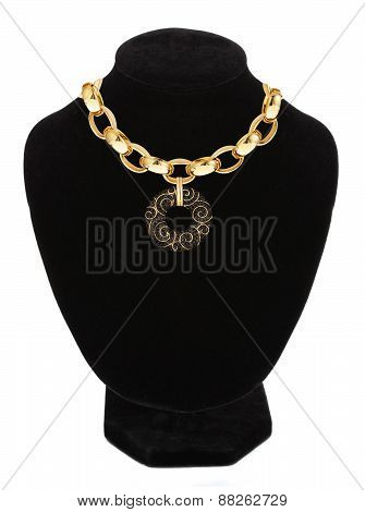 Beautiful Golden Necklace On Mannequin Isolated On White