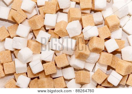 Cubes of white and brown sugar