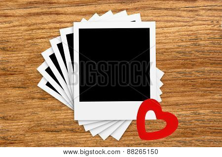 Film Vintage Empty Photo Cards And Red Heart On Wood Background