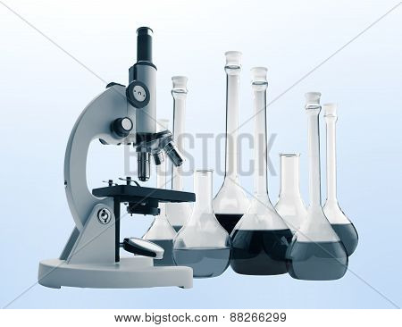 Laboratory Metal Microscope And Test Tubes With Liquid Toning In Blue