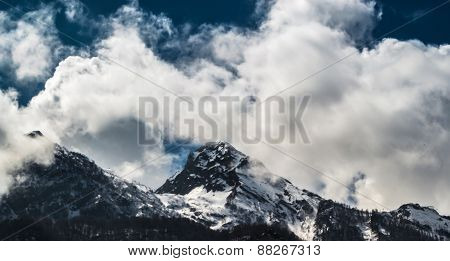 Alpine Mountains And Clouds