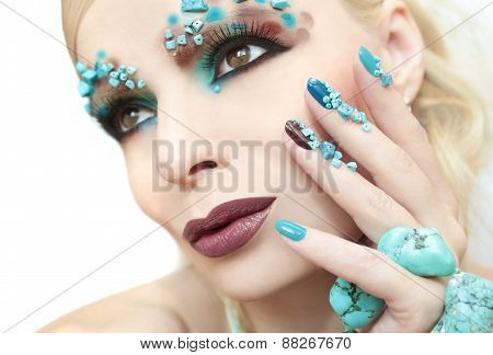 Manicure with stones of turquoise.