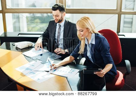 Businesswoman Pointing At Business Document During Discussion At Meeting