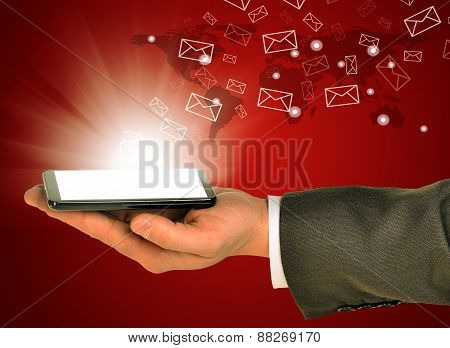 Business man holding a mobile phone within left hand