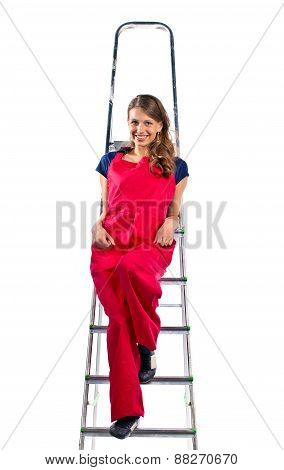 Young Woman In  Red Jumpsuit On  Ladder