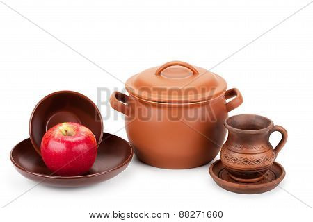 Earthen Pot, Jug, Plate And Ripe Apple