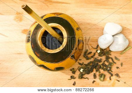 herbal tea mate in kalabas on wooden board