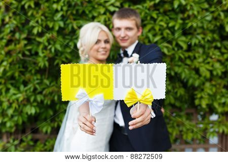 Bride And Groom Holding Plate In Your Hands