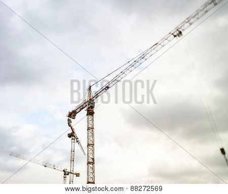 Crane And Building Construction Site Against The Sky