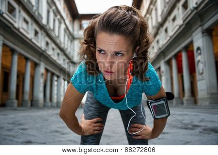 Fitness Woman Catching Breathe Near Uffizi Gallery In Florence, Italy