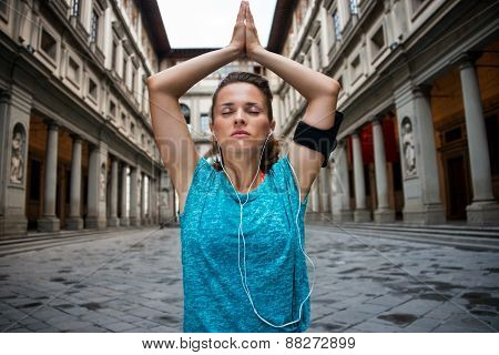 Fitness Woman Doing Yoga Near Uffizi Gallery In Florence, Italy