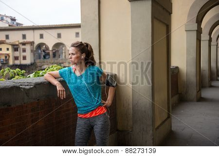 Fitness Woman Standing Not Far From Ponte Vecchio In Florence, I