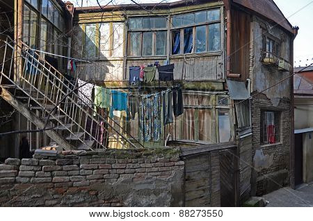 Tbilisi, Georgia-Feb,26 2015:Old house with stairs and the laundry on the clothesline in Tbilisi