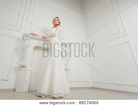 Full-length portrait of young gorgeous bride posing