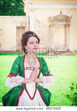 Beautiful Young Medieval Woman In Green Dress Praying