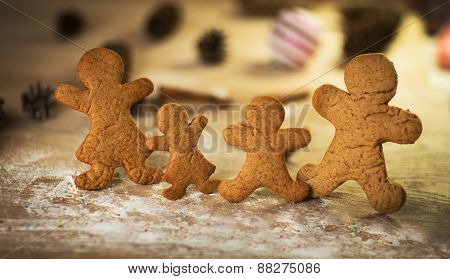 Gingerbread men made on the wooden table plate