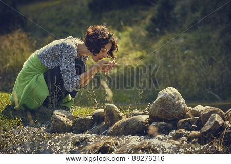 Woman Drinking Mountain Stream Water
