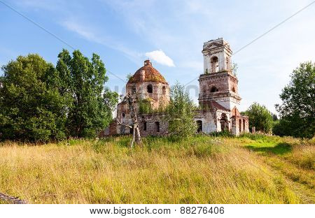 Typical Russian Landscape With Old Abandoned Church In Summertime