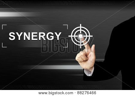 Business Hand Pushing Synergy Button On Touch Screen