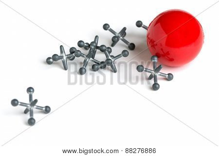 Jacks With Red Ball On White Background