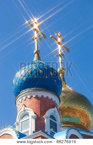 Domes Of Russian Orthodox Church With Cross Against Blue Sky