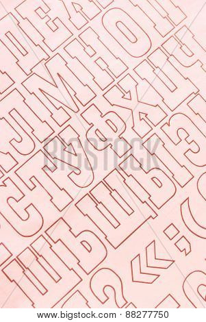 red cyrillic alphabet letters printed on white paper