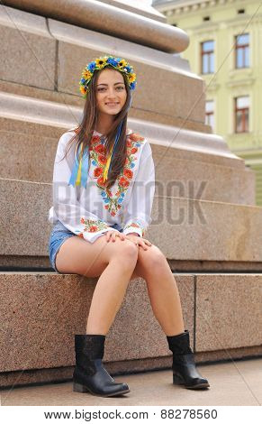 Pretty Ukrainian Girl Sits On Monument