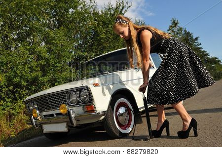 Young Woman Near White Old Car