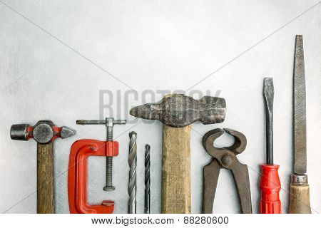 Set Of Old Tools On Metal Background