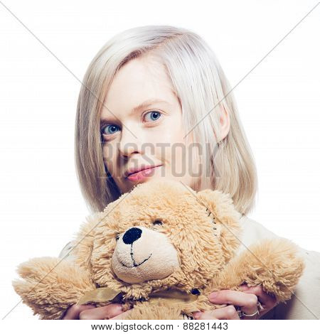 Young Blonde Woman With Teddy Bear