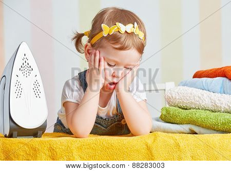 Tired Cute  Baby Girl Housewife Iron Clothes Iron, Is Engaged In Domestic Work