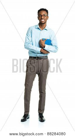 Happy African American College Student With Books In His Hands Standing On White