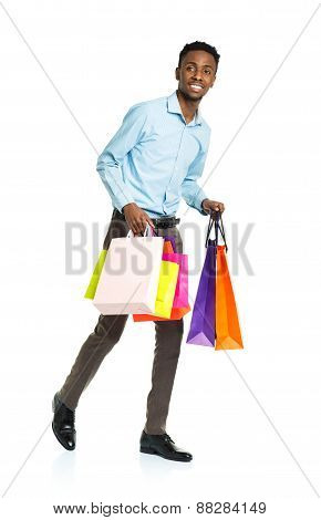 Happy African American Man Holding Shopping Bags On White Background