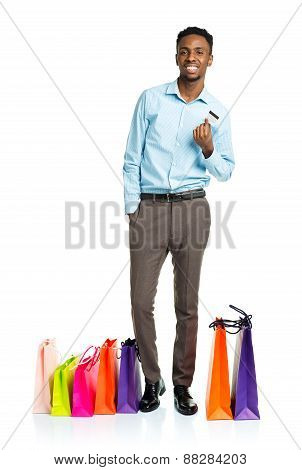 Happy African American Man With Shopping Bags And Holding Credit Card On White Background