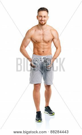 Athletic Man With Dumbbells On The White