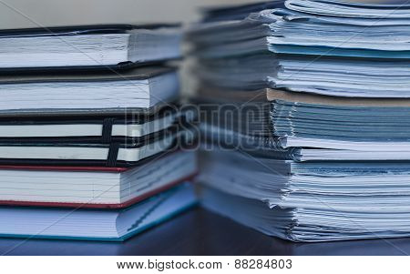 Accounting And Taxes. Large Pile Of Magazine And Books