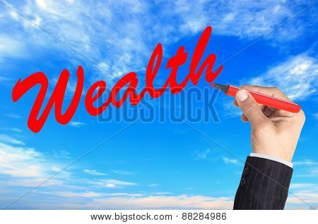 Hand Writing Word Wealth Over Blue Sky Background