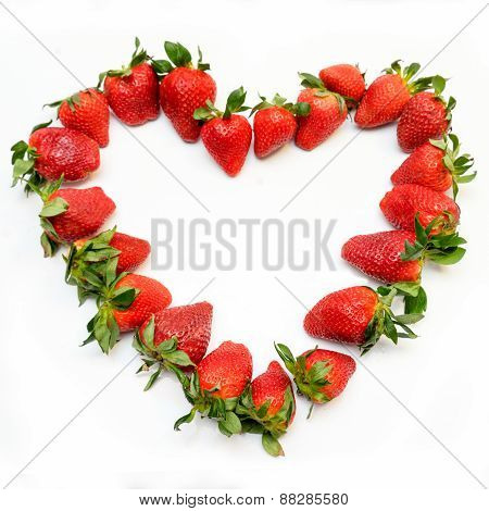 Shape Of Heart Made Of Strawberries On White Background