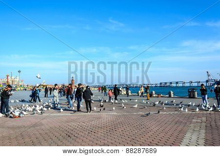 Dalian, China - April 7, 2015 : People Enjoy The Activities In Xinghai Square. The Square Covers Tot
