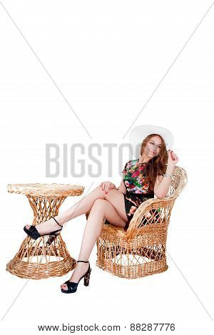 Girl In Summer Hat Isolated On Wicker Chair