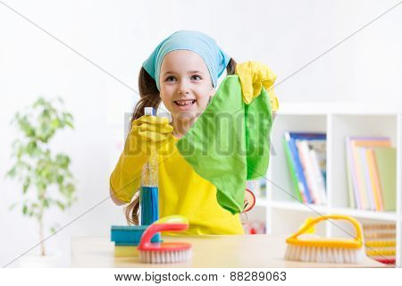 Little girl cleaning  at home