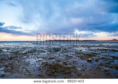 Sunset over the rocky shore of Baltic Sea