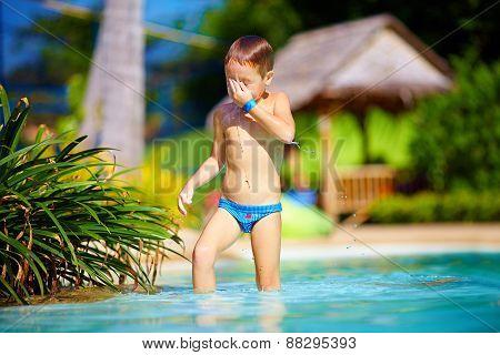 Cute Wet Kid, Boy Enjoying Vacation In Tropical Pool