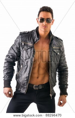 Handsome young man wearing leather jacket on naked torso, isolated