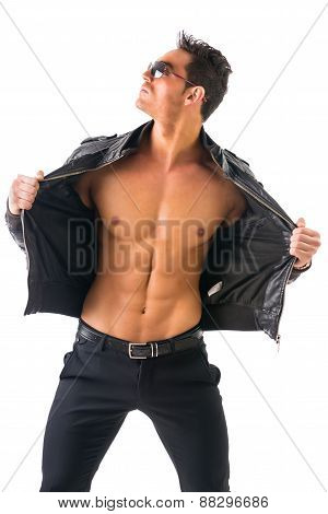 Handsome muscle man wearing leather jacket on naked torso, isolated