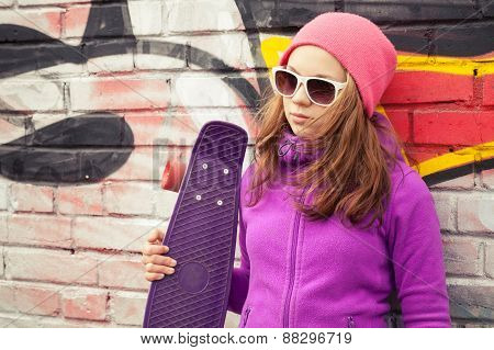 Blond Beautiful Teenage Girl Holds Skateboard