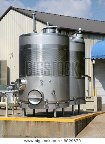 Wine fermenting or storage tanks