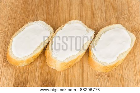 Row Of Several Small Sandwiches With Cream Cheese